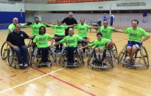 Isaac with wheelchair basketball players at Beit Halochem
