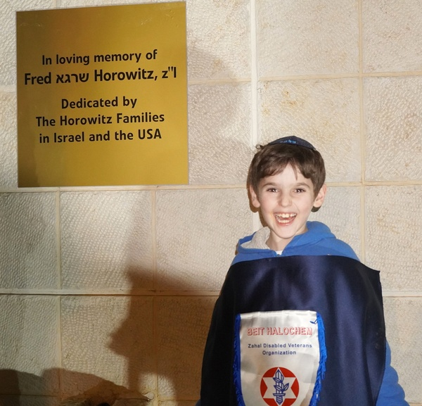 Grandson at the plaque.