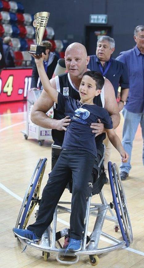 Dotan celebrates a win in wheelchair basketball.